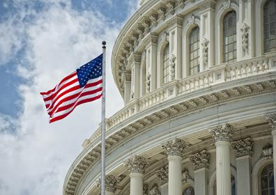 American Flag flying in front of the U.S. Capitol Building