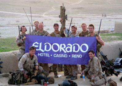 The military posing with the Eldorado Reno banner