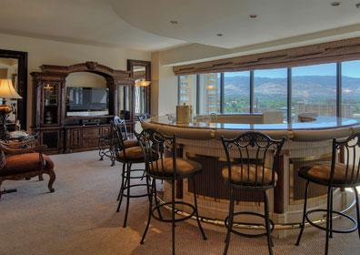 Suite for entertaining or a special occasion that includes a circular wet bar and a full-sized living room.