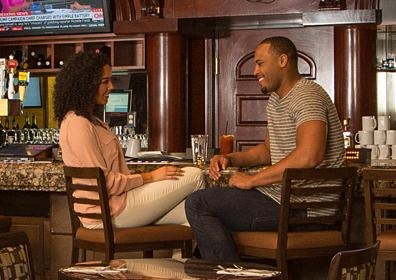Couple enjoying Millies24 Bar
