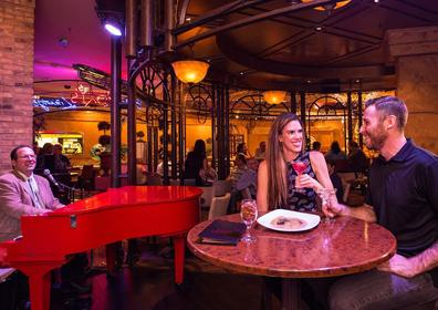 Couple enjoying Martini's in front of Live Piano Music
