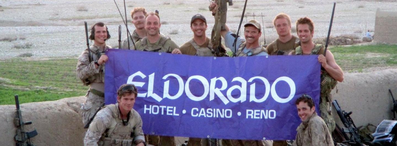 The military posing with the Eldorado Reno banner