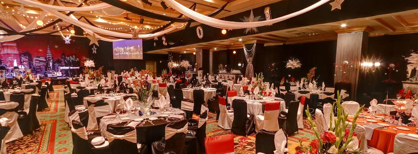 large ballroom with round tables and fancy table decorations