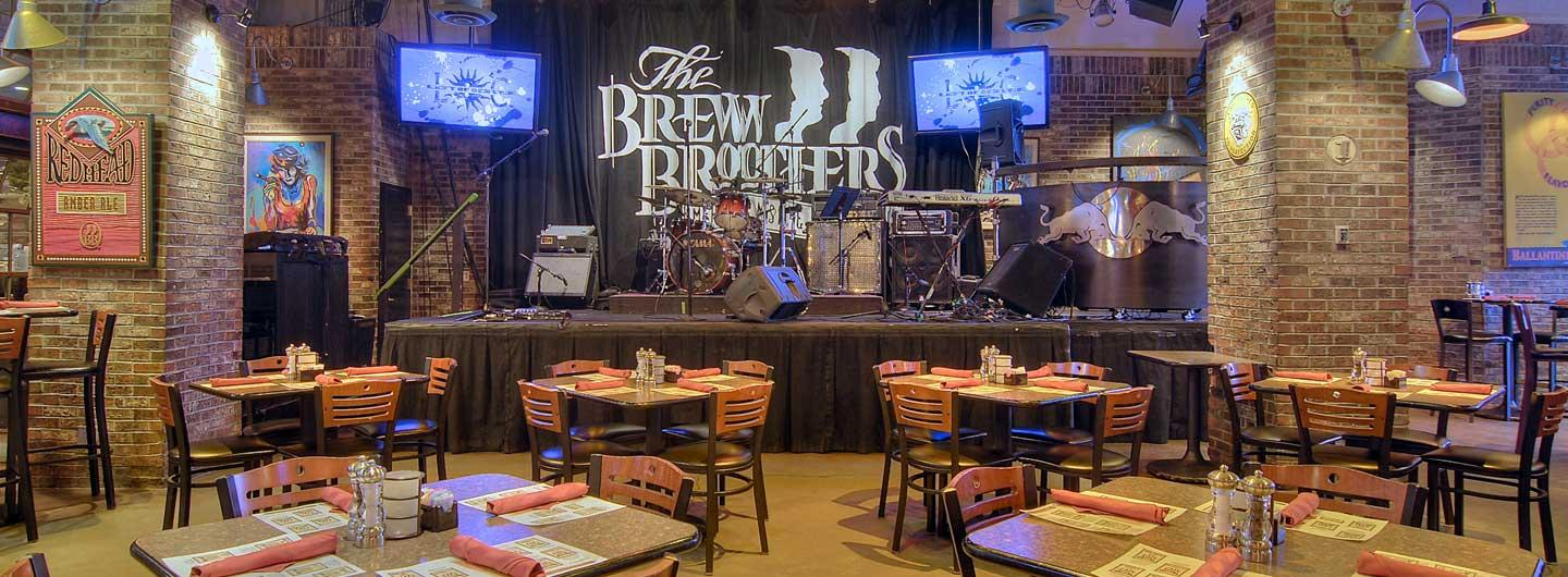 Dinner tables and the stage at Brew Brothers