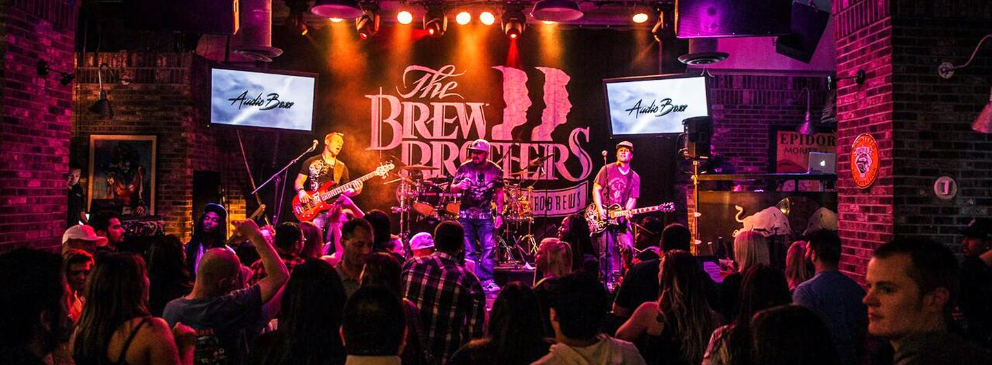 Band Playing at The Brew Brothers with large crowd