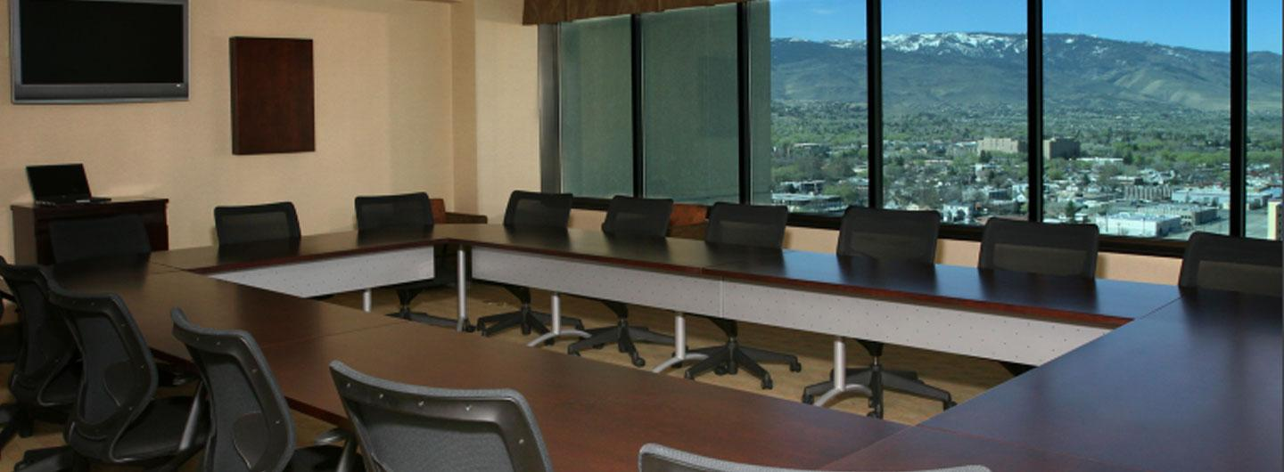 large tables and leather chairs with views of surrounding mountains