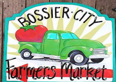 Farmer's Market logo with old pickup truck with giant tomato in the back
