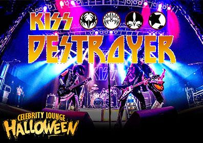 KISS band on stage with band logo