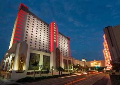 Street-side view of Eldorado Shreveport Hotel and parking garage at night