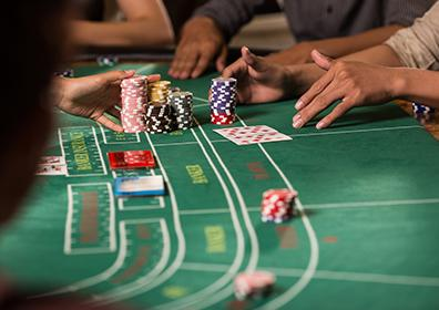 Dealer hands chips to player on poker table