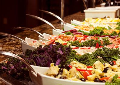 Row of dishes on salad bar
