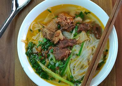 Bowl of pho with chopsticks and spoon