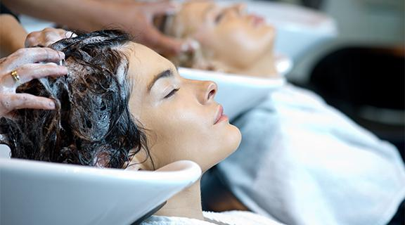 Two women getting hair washed at salon