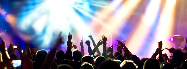Lights and a crowd enjoying a show