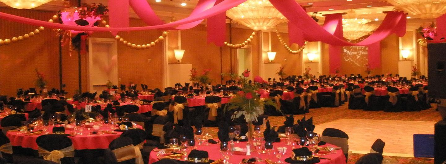 Ballroom decorated in black and pink for New Year's Eve party