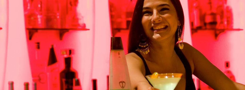 Bartender serving drink in Allure Ultra Lounge