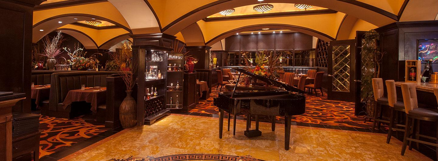 The Vintage entryway with bar, tables and piano