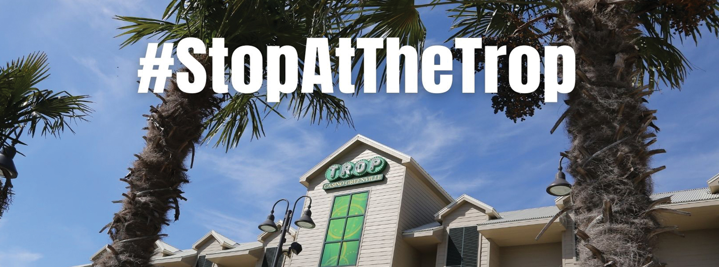 Entrance to Trop Greenville with the text overlay #StopAtTheTrop