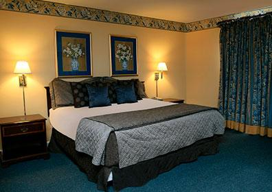 Photo of Parlor Suite room featuring King bed at Trop Casino Greenville