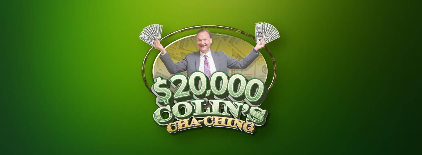 Colin holding the $20,000 Cha Ching prize