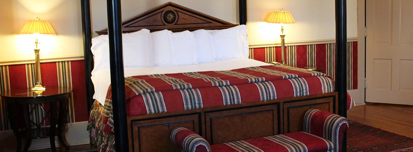 Photo of Executive Suite room featuring four post bed at Trop Casino Greenville