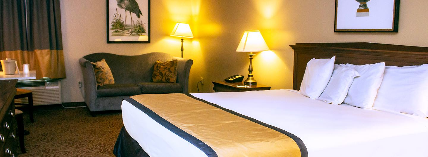 Photo of Standard King Room featuring bed at Trop Casino Greenville
