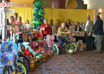 Group of people with toys to give to toys for tots