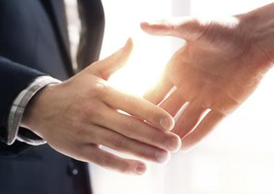 close-up handshake between two men