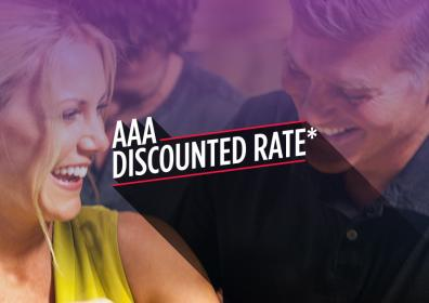 """picture of a couple smiling with the words """"AAA Discoutned Rate"""" on top"""
