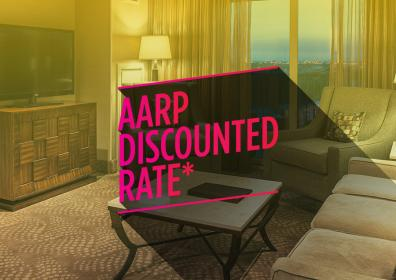 """picture of a hotel room with the words """"AARP Discounted Rate"""" on top"""
