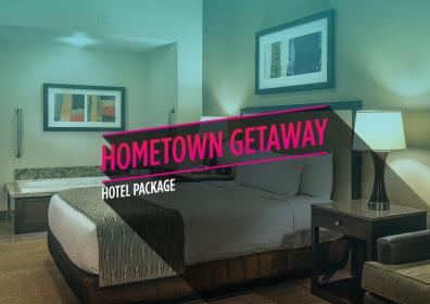 """hotel room picture with the words """"Hometown Getaway Hotel Package"""" on top"""