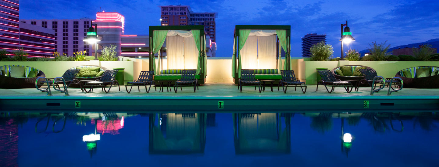 Pool view with cabanas at night