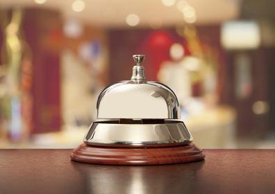 A bell at the front desk for concierge services