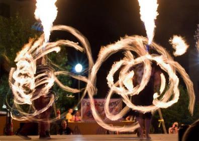2 people swinging fire in pattern