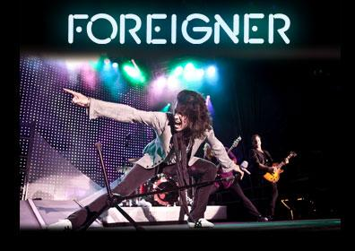 Foreigner performing at a concert