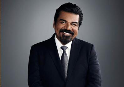 George Lopez in Black Suit on Grey background