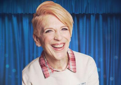 Lisa Lampanelli with Blue Curtain Background