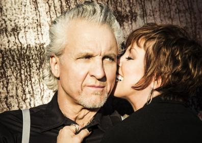 Pat Benatar and Neil Giraldo posing