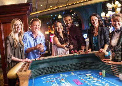 People playing the Table Game Craps.