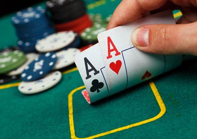 Playing poker with two aces and chips.