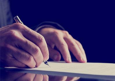 A man writing a testimonial