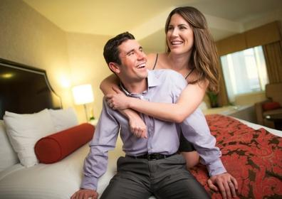 Happy couple relaxing in bed