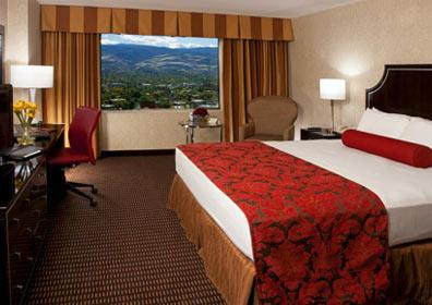 room with one king bed and stunning mountain views