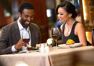 Two diners seated at a table at Sterling's Seafood Steakhouse