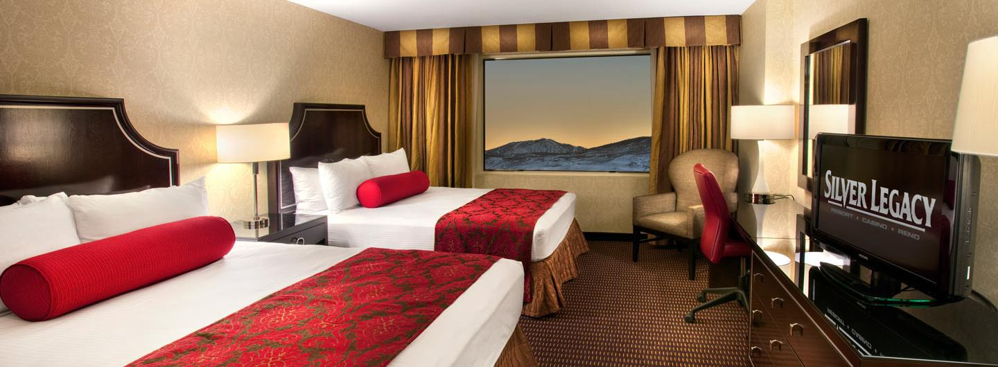 room with two queen beds and stunning mountain views