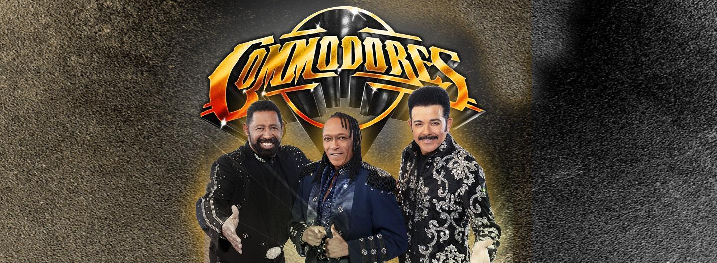 The Commodores band posing and smiling