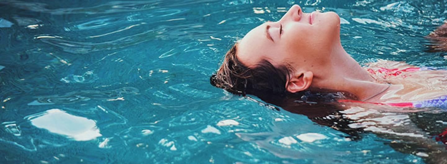woman floating in a pool on her back