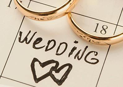 Picture of wedding rings on a calendar with a date circled