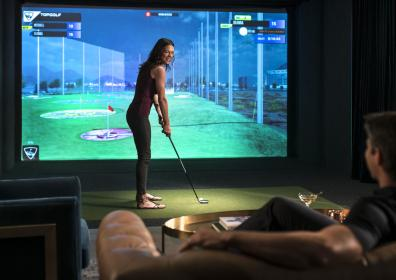 woman playing top golf