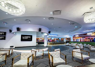 Picture of the sports bar lounge chairs and television
